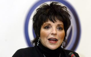 U.S. actress Liza Minelli promotes ''Cinema for Peace'' during the 54th Berlinale Film Festival in Berlin, Sunday, Feb. 8  2004. ''Cinema for Peace'' will hold a charity dinner in Berlin on Monday, Feb. 9. (AP Photo/Jockel Finck)