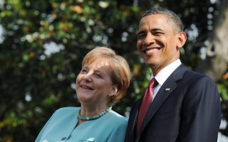 epa02770249 US President Barack Obama (R) meets German Chancellor Angela Merkel at the White House in Washington,D.C., USA, 07 June 2011. Obama welcomed German Chancellor Merkel to the White House for wide ranging discussions, but also to celebrate the long standing friendship shared by the two countries.    Merkel was greeted on the White House's South Lawn by music and a crowd of hundreds as part of the visit, which includes a rare state dinner - the first Obama has granted to a European leader.  EPA/RAINERJENSEN