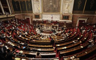 epa02247256 General view of the auditorium of the French National Assembly, in Paris, France, 13 July 2010, as the French parliament voted in favour to ban women from wearing full Islamic veils in public. The legislation make it illegal to wear the burka anywhere in public. Leftist deputies did not take part into the vote.  EPA/YOAN VALAT