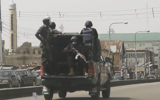 Nigerians forces patrol the streets of Kaduna, Nigeria Saturday, March 28, 2015. Nigerians went to the polls Saturday in presidential elections which analysts say will be the most tightly contested in the history of Africa's richest nation and its largest democracy. (AP Photo/Jerome Delay)