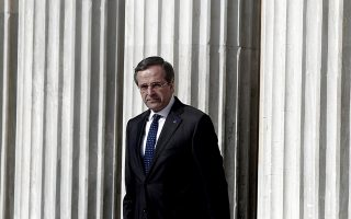 epa04012030 Greek Prime Minister Antonis Samaras waits for President of the European Commission Jose Manuel Barosso (not seen) at the Zappeion Hall in Athens, Greece, 08 January 2014. Greece prepared to officially launch its six-month presidency of the European Union. A plenary meeting between members of the Greek government and the College of Commissioners, chaired by Samaras and Barroso, was to be followed by a separate cluster of meetings between Commissioners and members of the Greek government.  EPA/ALKIS KONSTANTINIDIS