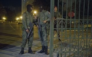 Masked Tunisian soldiers stand guard outside the National Bardo Museum, Tunis, Wednesday, March 18, 2015. Foreign tourists scrambled in panic Wednesday after militants stormed a museum in Tunisia's capital and killed scores of people,