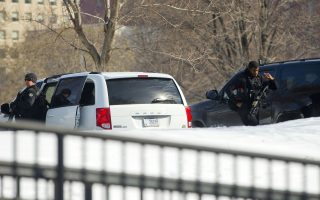 Members of the U.S. Secret Service's Counter Assault Team are visible near their vehicles on the North Lawn of the White House, Saturday, March 7, 2015, in Washington. President Barack Obama and the first family were to travel Saturday to Selma, Ala., for the 50th anniversary of