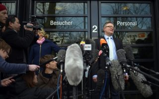 Christoph Kumpa (R), spokesman of Duesseldorf's public prosecution, stands on March 30, 2015 in front of the prosecution's building in Duesseldorf, western Germany, and addresses journalists waiting for new information in the context of the Germanwings plane crash. Officials say that the co-pilot of a Germanwings A320 Airbus plane that crashed on March 24, 2015 in the French Alps locked the captain out of the cockpit of the Airbus jet and deliberately crashed Flight 4U 9525, bound for Duesseldorf from Barcelona. The plane is said to have crashed at a speed of 700 kilometres (430 miles) per hour, killing all 150 on board instantly.     AFP PHOTO / SASCHA SCHUERMANN