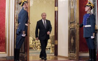Russian President Vladimir Putin, left, enters a hall for a meeting of CSTO (Collective Security Treaty Organization) in Moscow's Kremlin, Russia, Tuesday, Dec. 23, 2014.(AP Photo/ Maxim Shipenkov, pool)