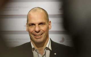 epa04720032 Greek Finance Minister Yanis Varoufakis has a smsile for the cameras during a group photo opportunity at the Informal Meeting of Ministers for Economic and Financial Affairs (ECOFIN) in Riga, Latvia 25 April 2015.  EPA/VALDA KALNINA