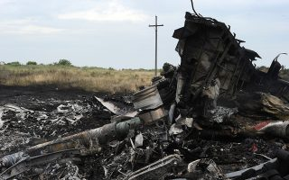 FILES - A picture taken on July 18, 2014 shows the wreckages of the Malaysia Airlines jet carrying 298 people from Amsterdam to Kuala Lumpur a day after it crashed, near the town of Shaktarsk, in rebel-held east Ukraine. Berlin knew the risks of flying over war-torn east Ukraine before flight MH17 was shot out of the sky but did not inform German airlines, local media reported on Sunday, April 26, 2015.   AFP PHOTO / DOMINIQUE FAGET