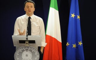 Italian Prime Minister Matteo Renzi holds a press conference at the end of the two-day European Council summit at the EU headquarters in Brussels on March 21, 2014.  AFP PHOTO / JOHN THYS