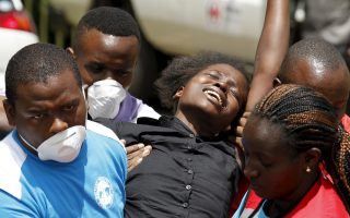 A relative is assisted by Kenya Red Cross staff where bodies of the students killed in Thursday's attack by gunmen, are preserved at the Chiromo Mortuary in the capital Nairobi April 4, 2015. Somali militants vowed on Saturday to wage a long war against Kenya and run its cities