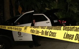epa04688429 The Los Angeles police department sets up a perimeter outside a home in the Hollywood Hills which belongs to Andrew Getty, in Los Angeles, California, USA, 31 March 2015. According to news reports Andrew Getty, 47, a grandson of oil tycoon J. Paul Getty and part of the Getty trust was found dead in his house in Hollywood.  EPA/NINA PROMMER