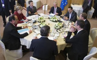 From left clockwise, French President Francois Hollande, German Chancellor Angela Merkel, Dutch Finance Minister Jeroen Dijsselbloem, European Commission President Jean-Claude Juncker, Greek Prime Minister Alexis Tsipras, European Council President Donald Tusk, Secretary General of the Council Uwe Corsepius and European Central Bank Governor Mario Draghi participate in a round table meeting on Greece at an EU summit in Brussels on Thursday, March 19, 2015. German Chancellor Angela Merkel said Thursday that Greece has no choice but to carry out economic reforms if it wants to receive more financial aid, dashing any hopes Athens might have had for a softening in Berlin's stance. (AP Photo/Yves Herman, Pool)