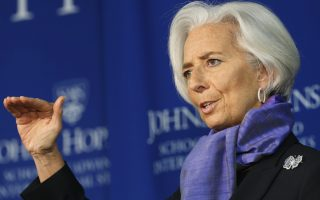 International Monetary Fund Managing Director Christine Lagarde gestures as she speaks about the global economy at the Johns Hopkins School of Advanced International Studies in Washington April 2, 2014. The European Central Bank should ease monetary policy to combat the risk of