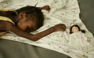 A girl waits for to be attended at the pediatric room iof the general Hospital of Port-au-Prince, Haiti, Wednesday, Dec. 13, 2006. Doctors are on the second-week of a strike demanding higher paying salaries. (AP Photo/Ariana Cubillos)