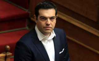epa04660895 Greek Prime Minister Alexis Tsipras looks on during the swearing-in ceremony of Greek President Prokopis Pavlopoulos before the Parliament in Athens, Greece, 13 March 2015. Prokopis Pavlopoulos, former minister with the New Democracy conservative party, who was nominated by the ruling leftist SYRIZA party, was sworn in as Greece's 7th President in Greece's highest office and was backed by 233 in attendance of 300 MPs in Parliament when the vote took place on February 18.  EPA/SIMELA PANTZARTZI