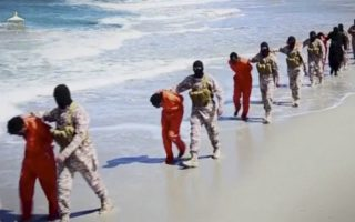Islamic State militants lead what are said to be Ethiopian Christians along a beach in Wilayat Barqa, in this still image from an undated video made available on a social media website on April 19, 2015. The video purportedly made by Islamic State and posted on social media sites on Sunday appeared to show militants shooting and beheading about 30 Ethiopian Christians in Libya. Reuters was not able to verify the authenticity of the video but the killings resemble past violence carried out by Islamic State, an ultra-hardline group which has expanded its reach from strongholds in Iraq and Syria to conflict-ridden Libya. Libyan officials were not immediately available for comment. Ethiopia said it had not been able to verify whether the people shown in the video were its citizens. REUTERS/Social Media Website via Reuters TVATTENTION EDITORS - THIS PICTURE WAS PROVIDED BY A THIRD PARTY VIDEO. REUTERS IS UNABLE TO INDEPENDENTLY VERIFY THE AUTHENTICITY, CONTENT, LOCATION OR DATE OF THIS IMAGE. THIS PICTURE IS DISTRIBUTED EXACTLY AS RECEIVED BY REUTERS, AS A SERVICE TO CLIENTS.