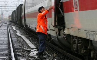 A Swiss policeman examines the wreckage of a crashed ICE train in Thun April 28, 2006. At least eight people were injured after a German ICE train, travelling from Interlaken to Berlin, collided head on with a Swiss BLS train and derailed in central Switzerland early on Friday.  REUTERS/Ruben Sprich