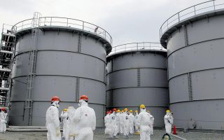 Tanks of radiation-contaminated water are seen at the Tokyo Electric Power Co (TEPCO)'s tsunami-crippled Fukushima Daiichi nuclear power plant in Fukushima prefecture in this file photo released by Kyodo on March 1, 2013. The operator of the crippled Fukushima nuclear plant said on October 1, 2013 that four tonnes of rainwater that may be contaminated leaked during a transfer of radioactive water between tank holding areas. Mandatory Credit REUTERS/Kyodo/Files (JAPAN - Tags: DISASTER ANNIVERSARY BUSINESS) ATTENTION EDITORS - THIS IMAGE HAS BEEN SUPPLIED BY A THIRD PARTY. IT IS DISTRIBUTED, EXACTLY AS RECEIVED BY REUTERS, AS A SERVICE TO CLIENTS. FOR EDITORIAL USE ONLY. NOT FOR SALE FOR MARKETING OR ADVERTISING CAMPAIGNS. JAPAN OUT. NO COMMERCIAL OR EDITORIAL SALES IN JAPAN. MANDATORY CREDIT. YES