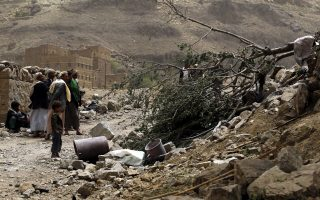 epa04691984 Yemenis inspect the scene of an airstrike of the Saudi-led coalition which allegedly hit houses while targeting Houthi rebels' positions in the village of Hajer Akash, Sana'a, Yemen, 04 April 2015. At least 10 people were killed and dozens wounded in an airstrike by a Saudi-led coalition on the village of Hajer Akash of Sana'a province, the residents said. Coalition jets overnight targeted a camp manned by rebel Houthis in the eastern part of Sana'a, but one of their missiles mistakenly hit