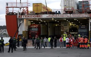 Unidentified ferry passengers are evacuated onto the dockside from a cargo ship as they arrive at port in Palma, Spain, Tuesday April 28, 2015, after they were evacuated from of a burning ferry in Spanish waters between Palma de Mallorca and Valencia.  The fire broke out about 27 Km (17 miles) from the Mediterranean island city of Palma de Mallorca Tuesday, forcing 152 passengers to abandon the ship in lifeboats and injuring four crew members, Spanish officials said. The burning ferry is expected to sink and the cause of the fire is under investigation.  (AP Photo/ Joan Llado)