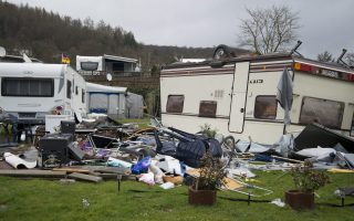 epa04688611 Camping furniture lies in front of an overturned mobile home at a camping site in Bad Karlshafen, Germany, 01 April 2015. Cyclone 'Niklas' knocked over multiple campers on 31 March 2015.  EPA/SWEN PFOERTNER