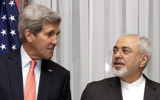 FILE - In this March 16, 2015 file photo U.S. Secretary of State John Kerry, left, listens to Iran's Foreign Minister Mohammad Javad Zarif, right, before resuming talks over Iran's nuclear program in Lausanne, Switzerland. The State Department said Kerry and Iran's Foreign Minister Mohammad Javad Zarif would meet Monday, April 27, 2015 at the United Nations on the sidelines of a conference on the nuclear non-proliferation treaty in which both men are participating.  (AP Photo/Brian Snyder, Pool, File)