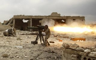 A rebel fighter of 'Al-Sultan Murad' brigade fires an anti-tank missile towards forces loyal to Syria's President Bashar al-Assad near Aleppo's international airport May 9, 2015. REUTERS/Rami Zayat