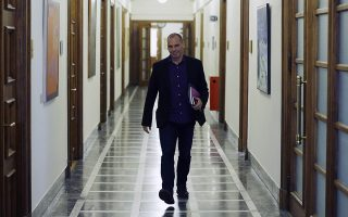 Greece's Finance Minister Yanis Varoufakis arrives for an inner meeting at the parliament in Athens on Tuesday, Feb. 24, 2015. Caught between its campaign pledges and pressure from creditors, Greece's left-wing Syriza government delivered the list on the cusp of Monday night's deadline. The government was asked to present a list last Friday at a meeting of the 19 finance ministers of the eurozone so its bailout request could be met. (AP Photo/Thanassis Stavrakis)