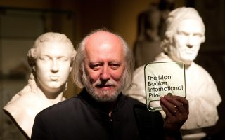 Hungary's Laszlo Krasznahorkai, the winner of the Man Booker International Prize, poses for photographers with the trophy shortly after the award ceremony at the Victoria and Albert Museum in London, Tuesday, May 19, 2015.  The Man Booker International Prize is awarded every two years to a living author for a body of work published either originally in English or available in translation in the English language.  (AP Photo/Matt Dunham)