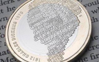 This picture made available by Britain's Royal Mint taken Nov. 9, 2011, shows the reverse of the new 2 pound sterling coin with the image of Charles Dickens, made up from some of the titles of his most famous novels, which has been created to celebrate the 200th anniversary of his birth on 7 February 1812. (AP Photo/David Parry) EDITORIAL USE ONLY