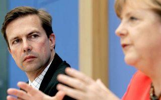 O Γερμανός κυβερνητικός εκπρόσωπος Στέφεν Ζάιμπερτ με την Γεμρανίδα καγκελάριο Ανγκελα Μέρκελ.