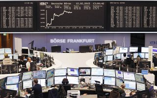 The curve of the German stock index DAX is displayed on a board at the stock market in Frankfurt, Germany, Thursday, Feb. 12, 2015. (AP Photo/Michael Probst)