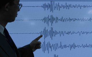 Japan Meteorological Agency's earthquake and tsunami observations division director Yasuo Sekita points at a graph of ground motion waveform data observed in the morning in Japan during a news conference on implications that an earthquake sourced around North Korea was triggered by an unnatural reason May 25, 2009. North Korea conducted an underground nuclear test on Monday, stoking tension across the  regional economic powerhouse of East Asia and prompting U.N. Security Council members to call an emergency meeting. REUTERS/Yuriko Nakao(JAPAN SCI TECH POLITICS ENVIRONMENT)