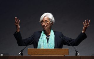 International Monetary Fund Managing Director Christine Lagarde gestures as she gives a speech during the World Assembly for Women (WAW! Tokyo 2014) in Tokyo September 12, 2014. Japanese Prime Minister Shinzo Abe's targets for empowering women, a key part of his economic growth strategy, could add substantially to annual growth if met, Lagarde said on Friday.  REUTERS/Yuya Shino (JAPAN - Tags: POLITICS BUSINESS TPX IMAGES OF THE DAY)
