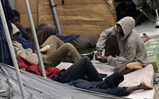 Would-be immigrants sit on their beds placed outside at the Hoya Fria holding center in Santa Cruz used to detain immigrants who arrived on the Canary Island of Tenerife from ports on the west African coast Friday, Sept. 29, 2006. Around 1500 immigrants are currently held in the holding center which was designed to hold 370. Spain insisted Friday that illegal immigration from Africa is a joint European Union problem, fending off charges that it encouraged a flood of people by granting amnesty to more than half a million undocumented foreigners. Spain's foreign and interior ministers made the assertion as they opened a meeting with colleagues from seven other EU countries on the Mediterranean rim to discuss how to patrol their maritime borders as wave after wave of destitute Africans try to reach the wealthy continent for a chance at a better life. (AP Photo/Arturo Rodriguez)