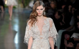 A model on the runway at Elie Saab spring 2015 haute couture show at Thιβtre National de Chaillot in Paris.<P><noscript><img width=