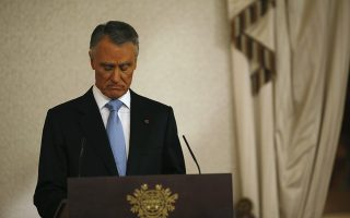 Portugal's President Anibal Cavaco Silva makes a statement to the media at Belem Palace in Lisbon July 10, 2013. Cavaco Silva said on Wednesday he wants the ruling coalition parties to reach an agreement with the opposition Socialists on holding elections after the country exits its international bailout next year. REUTERS/Rafael Marchante (PORTUGAL - Tags: POLITICS BUSINESS)