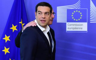 Greece's Prime Minister Alexis Tsipras (L) is welcomed by European Commission President Jean-Claude Juncker ahead of an emergency summit with the leaders of Athens' creditors at the European Commission in Brussels, on June 22, 2015. The European Central Bank (ECB) again increased emergency liquidity funds for Greece's banks on June 22, according to a Greek bank source who said the ECB may renew the hike