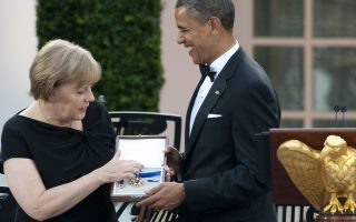 FILES - US President Barack Obama presents German Chancellor Angela Merkel with the 2010 Presidential Medal of Freedom during a State Dinner in the Rose Garden at the White House in Washington, DC, June 7, 2011, as part of an official visit. Germany on October 24, 2013 summoned the US ambassador to Berlin over suspicions that Washington spied on Chancellor Angela Merkel's mobile phone, a foreign ministry spokeswoman said.     AFP PHOTO / Saul LOEB