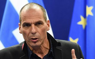 Greek Finance Minister Yanis Varoufakis gives a press conference on February 16, 2015 at the end of an Eurogroup finance ministers meeting at the European Council in Brussels. Eurozone ministers handed Greece an ultimatum to request an extension to its hated bailout program on February 16 after crunch talks collapsed, deepening a bitter stand-off that risks seeing Athens tumble out of the eurozone.  Eurogroup head Jeroen Dijsselbloem said Greece had the rest of the week to request an extension to the programme, which expires at the end of the month, challenging Athens to cave on a dearly held position.                AFP PHOTO / EMMANUEL DUNAND