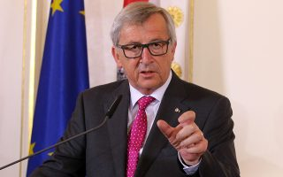 European Commission President Jean-Claude Juncker speaks as he attends a press conference after talks with Austrian Chancellor Werner Faymann at the federal chancellery in Vienna, Austria,Tuesday, April 21, 2015. (AP Photo/Ronald Zak)