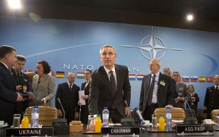 NATO Secretary General Jens Stoltenberg, center, chairs a meeting of the NATO-Ukraine Commission at NATO headquarters in Brussels on Thursday, June 25, 2015. NATO defense ministers meet for a second day of sessions to discuss, among other issues, the situation in Ukraine. (AP Photo/Virginia Mayo)