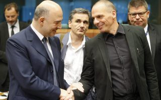 epa04821152 European commissioner in charge of Economic and Financial Affairs Pierre Moscovici (L) shakes hands with Greek Finance Minister Yanis Varoufakis (R) at the start of a special Eurogroup Finance ministers meeting on Greece crisis, at the EU council headquarters in Brussels, Belgium, 27 June 2015. Greece's parliament started debating the government's planned referendum on the creditors' latest bailout proposal at an emergency session on 27 June.  Greek voters will decide in a referendum whether their government should accept an economic reform package put forth by Greece's creditors, Greek Prime Minister Alexis Tsipras announces.  EPA/OLIVIER HOSLET