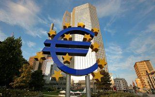 The euro sign sculpture stands outside the European Central Bank (ECB) headquarters in Frankfurt, Germany, on Saturday, Sept. 13, 2008. The European Central Bank may cut its deposit rate as soon as today in an effort to jolt banks into lending more to each other, economists said. Photographer: Hannelore Foerster/Bloomberg News