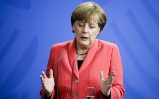 German Chancellor Angela Merkel briefs the media after a meeting with leaders of all parties represented in the German parliament about the Greece crisis, at the chancellery in Berlin, Monday, June 29, 2015. (AP Photo/Markus Schreiber)
