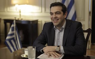 epa04772842 Greek Prime Minister Alexis Tsipras smiles during his meeting with Iran's Foreign Minister Mohammad Javad Zarif (not pictured) in Athens, Greece, 28 May 2015.  EPA/YANNIS KOLESIDIS