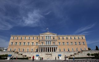 The Greek Parliament is seen in Athens, Monday, May 7, 2012. Bailout-reliant Greece faces weeks of financial turmoil after voters angry at crippling income cuts punished mainstream politicians, let a far-right extremist group into Parliament and gave no party enough votes to govern alone. (AP Photo/Thanassis Stavrakis)