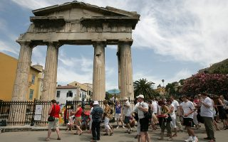 epa02152532 A group of tourists get ready to enter the Roman Forum in central Athens, beneath the Acropolis' north slope, on 11 May  2010. The all-important tourism sector is one of Greece's economic mainstays, and viewed as absolutely crucial for jumpstarting growth in the country amid the current debt crisis.  EPA/ORESTIS PANAGIOTOU