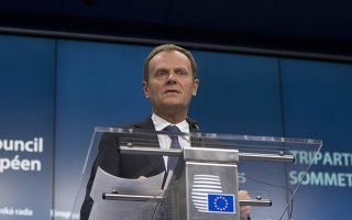 European Council President Donald Tusk speaks during a media conference at an EU summit in Brussels on Thursday, March 19, 2015. Ukraine is urging the European Union to stay united on keeping up sanctions pressure on Russia over the conflict in eastern Ukraine as EU leaders gather for a two-day summit. (AP Photo/Virginia Mayo)