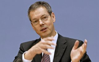 Peter Bofinger, a member of the German council of economic experts, talks at a press conference in Berlin, Germany on Wednesday, Nov. 7, 2007. Merkel's coalition risks undermining the country's economic expansion by flirting with plans to roll back business-friendly policies, the government's council of economic advisers said. Photographer: Jose Giribas/Bloomberg News
