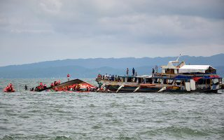 epaselect epa04827513 A general view of the ongoing search and rescue operation next to a motorized boat that capsized off Ormoc City, Leyte province, Philippines, 02 July 2015. At least 36 people were killed when a passenger boat capsized off the central Philippines on 02 July 2015, with 19 still missing, a coast guard spokesman said. Emergency teams rescued 118 people from the seas off Ormoc City in Leyte province, 560 kilometres south-east of Manila, where the accident happened, said Commander Armand Balilo. The boat was carrying 173 passengers and 16 crew members, according to Balilo and the police.  EPA/ROBERT DEJON